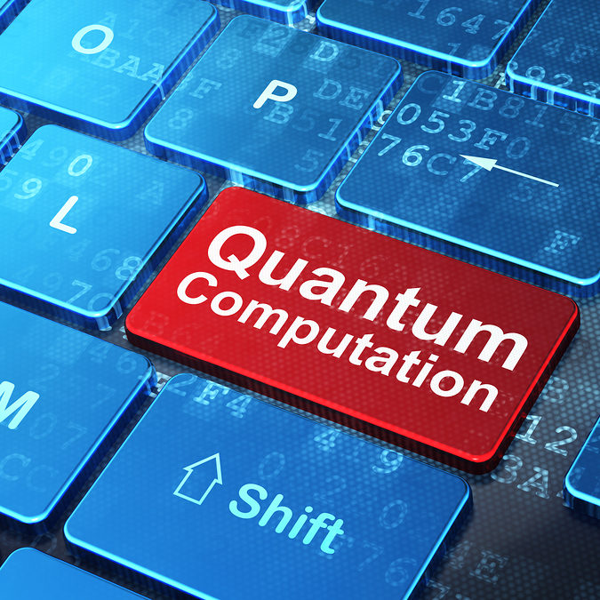 Science concept: Quantum Computation on computer keyboard backgr